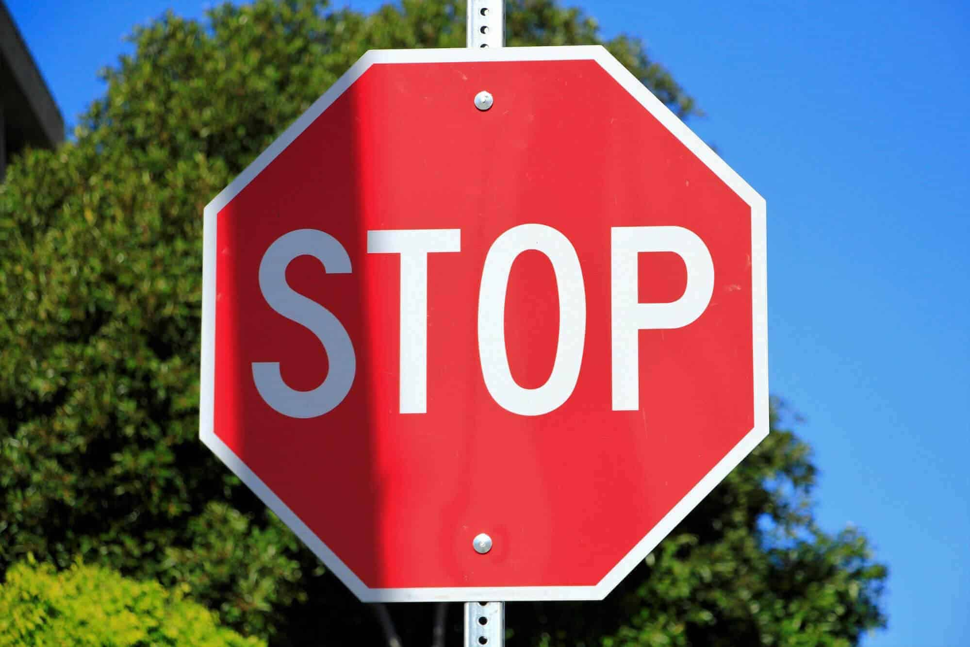 incomplete stops at stop signs result in an automatic fail