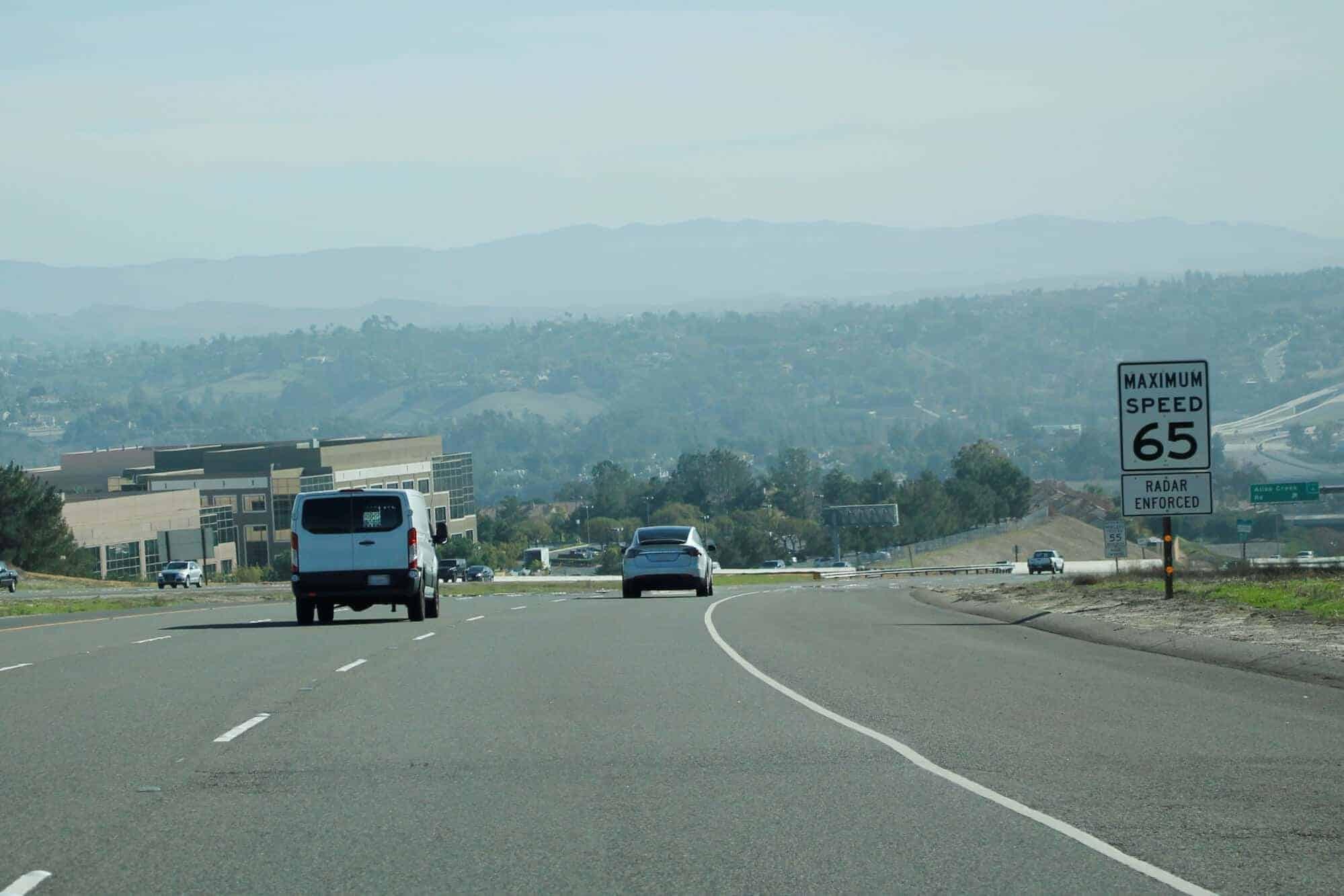 65 mph speed limit sign on freeway