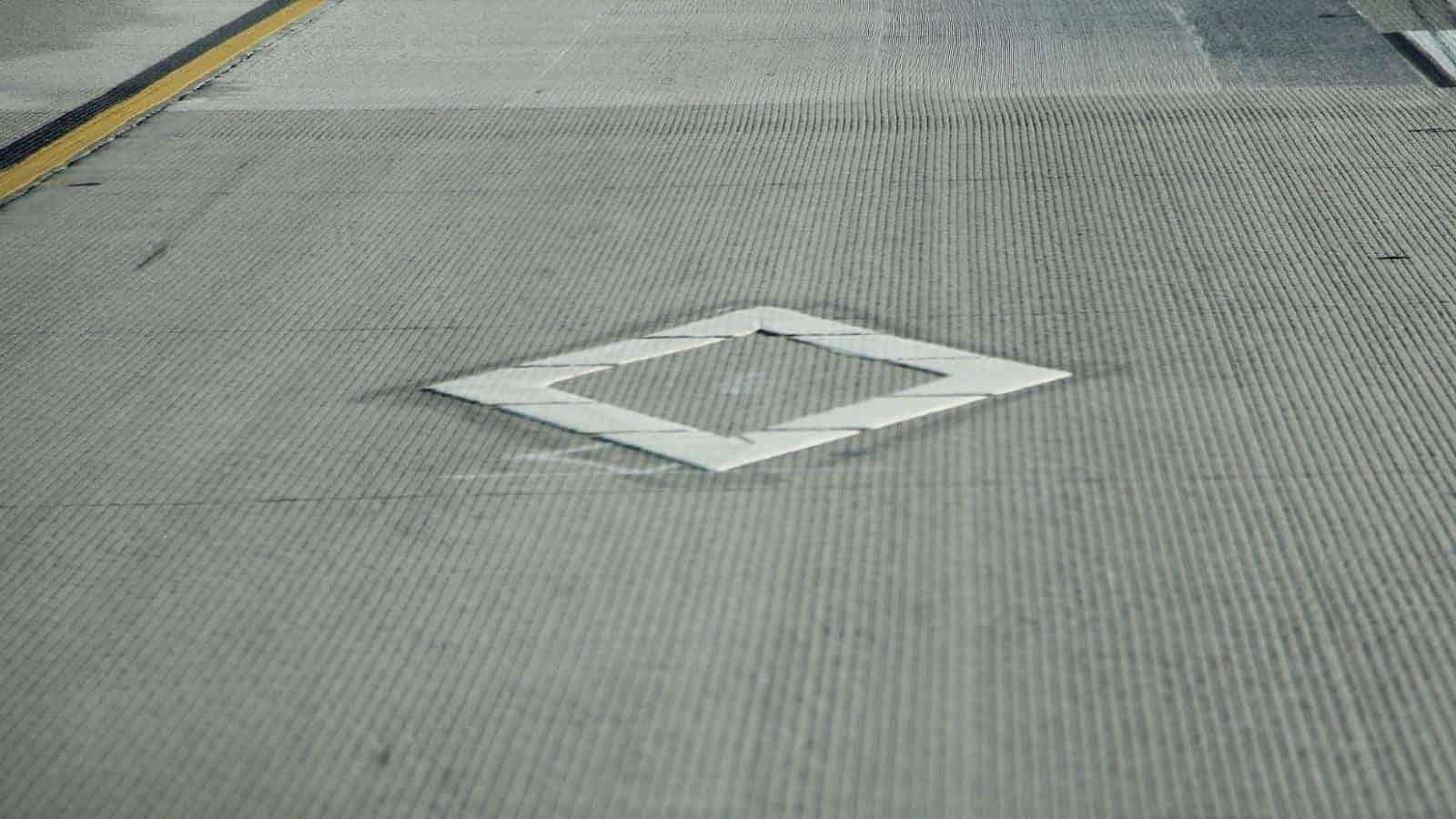 HOV lane diamond symbol road marking