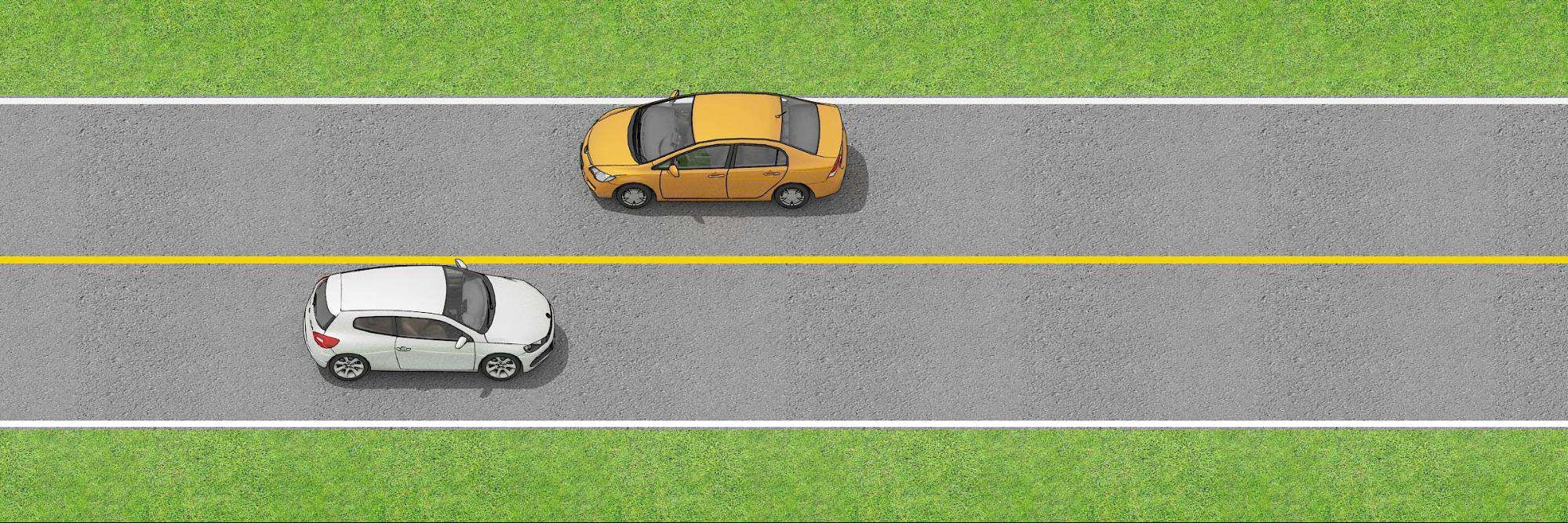 Two vehicles on the road separated by a single solid yellow  line